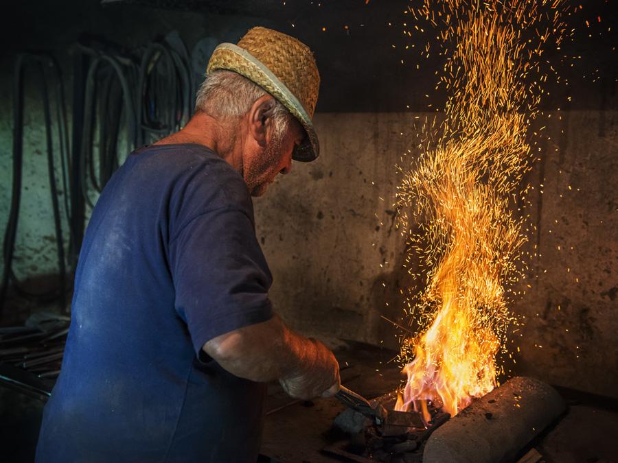 Blacksmith tending fire